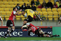 Hurricanes second five Ma'a Nonu leaps into a tackle. Super 15 rugby match - Hurricanes v Lions at Westpac Stadium, Wellington, New Zealand on Saturday, 4 June 2011. Photo: Dave Lintott / lintottphoto.co.nz