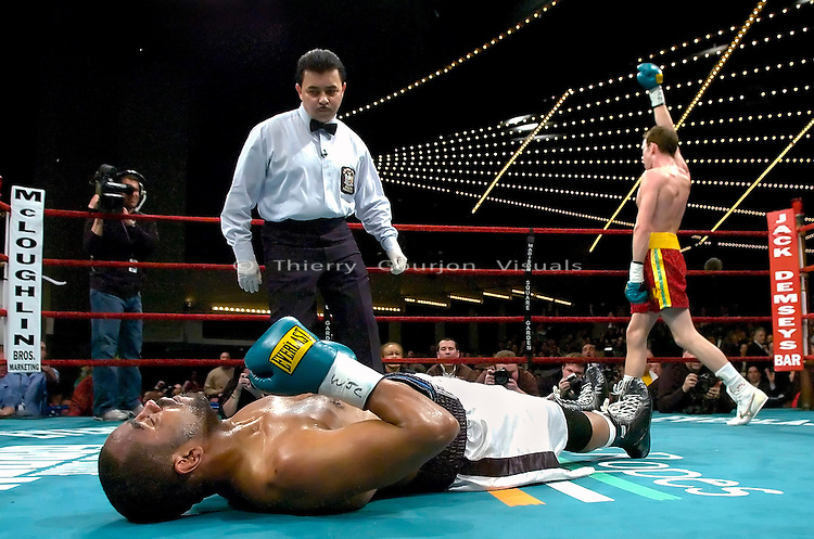 """Irish"" prospect Andy Lee celebrates while former world champion Carl Daniels is knocked out on the canvas during their 6 rounds Super Middleweight fight at the Garden in New York on 03.16.07..Lee won by 3rd round ko. Photo by Thierry Gourjon."