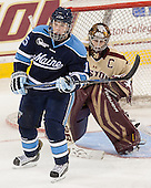 Kayla Kaluzny (Maine - 15), Corinne Boyles (BC - 29) - The Boston College Eagles defeated the visiting University of Maine Black Bears 5 to 1 on Sunday, October 6, 2013, in their Hockey East season opener at Kelley Rink in Conte Forum in Chestnut Hill, Massachusetts.