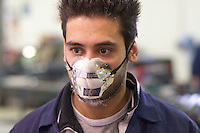 Student wearing a face mask, Motor Mechanics, Further Education College.