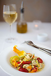 Alloro Restaurant, a fine dining restaurant located in Old Town Bandon, Oregon. Halibut stuffed pasta, zucchini blossoms, tomatoes, garlic, butter, chives.