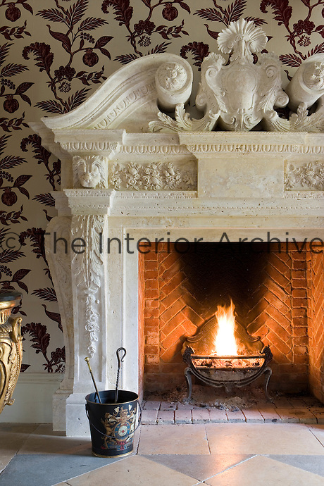 Close-up of large stone fireplace in the entrance to Pipewell Hall