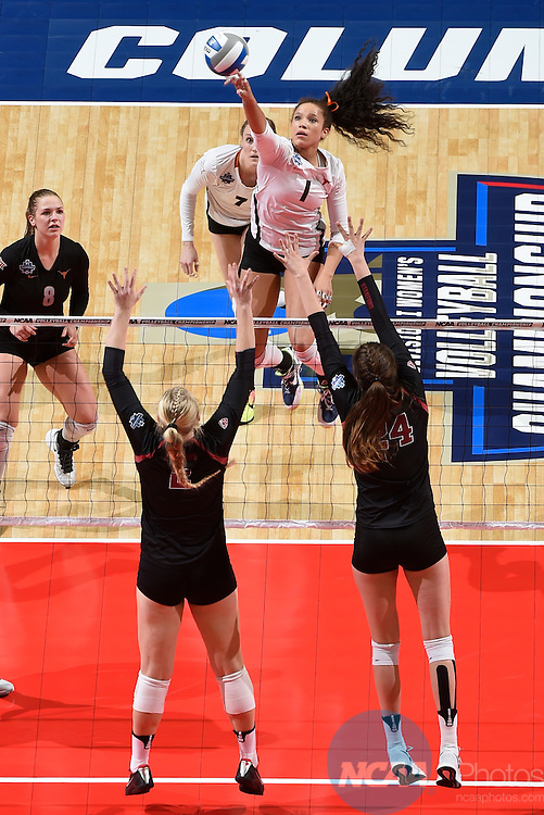 COLUMBUS, OH - DECEMBER 17:  Micaya White (1) of the University of Texas attempts a kill against Stanford University during the Division I Women's Volleyball Championship held at Nationwide Arena on December 17, 2016 in Columbus, Ohio.  Stanford defeated Texas 3-1 to win the national title. (Photo by Jamie Schwaberow/NCAA Photos via Getty Images)