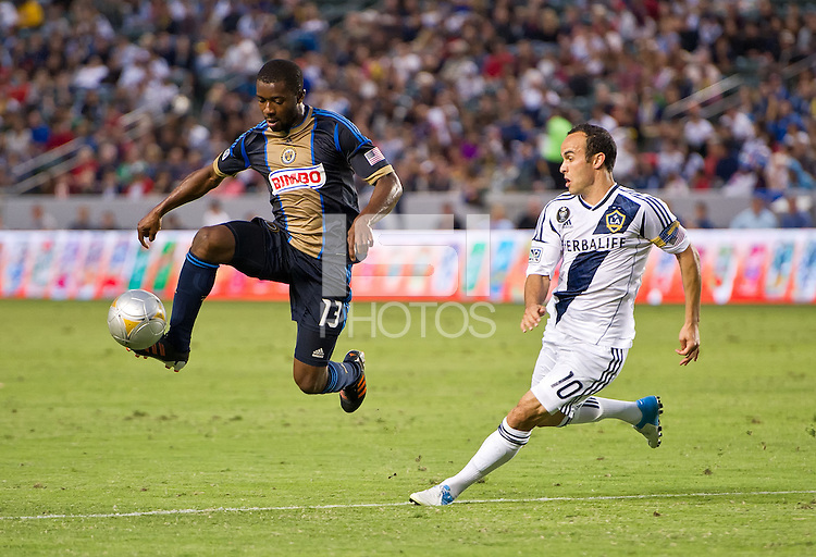 CARSON, CA - July 4, 2012: Philadelphia Union midfielder Michael Lahoud (13) and LA Galaxy forward Landon Donovan (10) during the LA Galaxy vs Philadelphia Union match at the Home Depot Center in Carson, California. Final score LA Galaxy 1, Philadelphia Union 2.