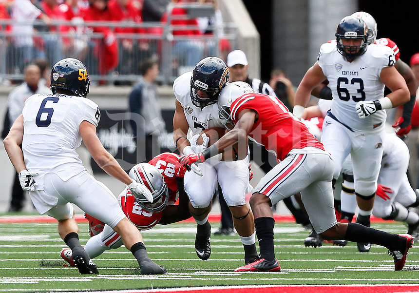 Ohio State Buckeyes defensive back Vonn Bell (11) stops Kent State Golden Flashes tight end Casey Pierce (7) during the second quarter, at Ohio Stadium in Columbus, Saturday, September 13, 2014. (Dispatch Photo by Jenna Watson)