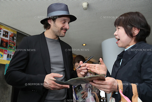 "May 1, 2016, Chiba, Japan - Italian movie star Claudio Santamaria chats with a Japanese fan after he gave his autograph at the Iwanami hall as his movie ""Jorneranno i Prati"" is screening at the movie theatre in Tokyo on Sunday, May 1, 2016. Santamaria is now here to attend the Italian movie festival in Tokyo.  (Photo by Yoshio Tsunoda/AFLO) LWX -ytd-"