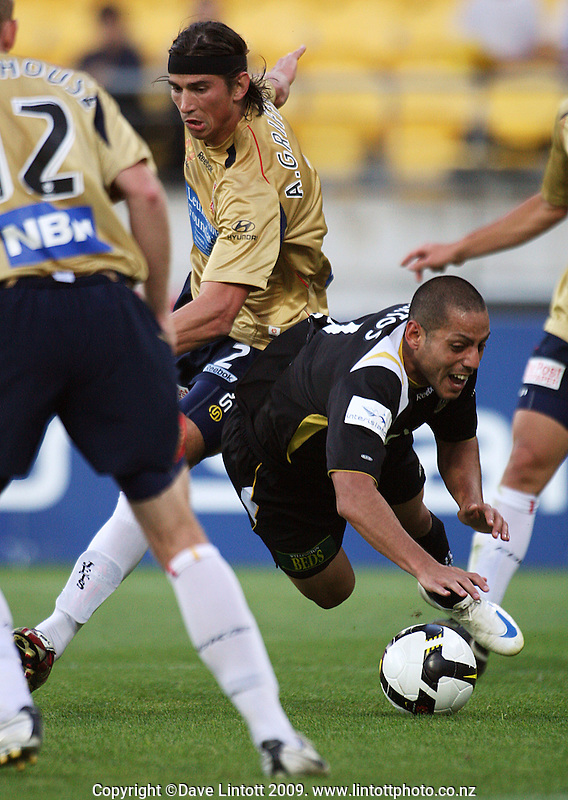 Newcastle's Adam Griffiths and Phoenix' Leo Bertos clash in the penalty box during the A-League match between Wellington Phoenix and Newcastle Jets at Westpac Stadium, Wellington, New Zealand on Sunday, 4 January 2009. Photo: Dave Lintott / lintottphoto.co.nz