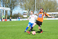 VOETBAL: URK: Sportpark 'de Vormt', SV Urk - Drachtster Boys, 14-04-2012, Zaterdag Hoofdklasse C, William de Boer (#11 Urk), Richard Hamstra (#2 DB) aan de bal, Eindstand 2-3, ©foto Martin de Jong