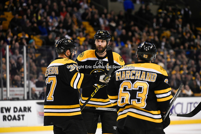February 24, 2015 - Boston, Massachusetts, U.S. - Boston Bruins defenseman Zdeno Chara (33) talks to center Patrice Bergeron (37) and left wing Brad Marchand (63) during the first period of the NHL match between the Vancouver Canucks and the Boston Bruins held at TD Garden in Boston Massachusetts. Eric Canha/CSM