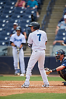 Tampa Tarpons third baseman Angel Aguilar (7) at bat in front of catcher Austin Athmann (19) during a game against the Lakeland Flying Tigers on April 8, 2018 at George M. Steinbrenner Field in Tampa, Florida.  Lakeland defeated Tampa 3-1.  (Mike Janes/Four Seam Images)