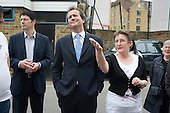 Conservative MP Nick Hurd, newly appointed Minister for Civil Society, talks with Neighbourhood Manager Marco Torquati and Neighbourhood Forum Chair Jeannette Buckley during a visit to projects in Church Street, London,  supported by the Paddington Development Trust.