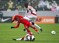 CARSON, CA - March 25, 2012: Jamal Gay (9) of Panama and Carlos Rodriguez (4) during the Panama vs Trinidad & Tobago match at the Home Depot Center in Carson, California. Final score Panama 1, Trinidad & Tobago 1.