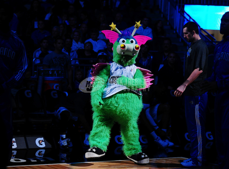 Feb. 11, 2011; Orlando, FL, USA; Orlando Magic mascot Stuff the Magic Dragon makes an appearance before the game against the New Orleans Hornets at the Amway Center. The Hornets defeated the Magic 99-93. Mandatory Credit: Mark J. Rebilas-USA TODAY Sports