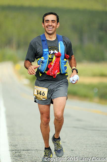 August 22, 2015 - Leadville, Colorado, U.S. - Colorado runner, Rodrigo Jimenez, is in good spirits as he reaches the Colorado Outward Bound 23 mile Aid Station during the Leadville Trail 100, Leadville, CO.