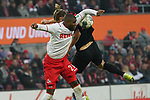 30.11.2019, RheinEnergieStadion, Koeln, GER, 1. FBL, 1.FC Koeln vs. FC Augsburg,<br />  <br /> DFL regulations prohibit any use of photographs as image sequences and/or quasi-video<br /> <br /> im Bild / picture shows: <br /> Kopfballduell zwischen  Anthony (Toni) Modeste (FC Koeln #27), Tin Jedvaj (FC Augsburg #18),  <br /> <br /> Foto © nordphoto / Meuter
