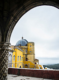 PORTUGAL, Sintra, View of Pena Palace and one of its dome. Forest in the background