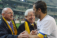 MELBOURNE, 17 JUNE 2009 - The Australian captain Lucas Neill is congratulated by Football Australia's John Boultbee and Frank Lowy after his team's win in an Asia group 1 qualification match for the FIFA 2010 World Cup between Australia and Japan at the MCG, Melbourne, Australia. 17 June 2009. Photo Sydney Low. This photograph is NOT FOR SALE.
