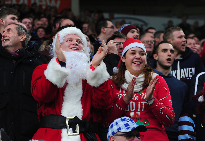Burnley fans, dressed as Father Christmas, during the first half <br /> <br /> Photographer Chris Vaughan/CameraSport<br /> <br /> Football - The Football League Sky Bet Championship - Hull City v Burnley - Saturday 26th December 2015 - Kingston Communications Stadium - Hull<br /> <br /> &copy; CameraSport - 43 Linden Ave. Countesthorpe. Leicester. England. LE8 5PG - Tel: +44 (0) 116 277 4147 - admin@camerasport.com - www.camerasport.com