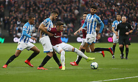 West Ham United's Aaron Cresswell and Huddersfield Town's Tommy Smith<br /> <br /> Photographer Rob Newell/CameraSport<br /> <br /> The Premier League - West Ham United v Huddersfield Town - Saturday 16th March 2019 - London Stadium - London<br /> <br /> World Copyright © 2019 CameraSport. All rights reserved. 43 Linden Ave. Countesthorpe. Leicester. England. LE8 5PG - Tel: +44 (0) 116 277 4147 - admin@camerasport.com - www.camerasport.com