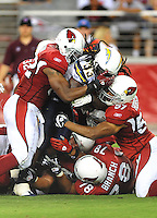 Aug. 22, 2009; Glendale, AZ, USA; San Diego Chargers running back (33) Gartrell Johnson is tackled by several Arizona Cardinals defenders during a preseason game at University of Phoenix Stadium. Mandatory Credit: Mark J. Rebilas-