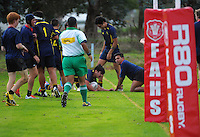 Action from the Manawatu secondary schools grading match between Feilding High School 3rd XV (red, navy and white)) and Freyberg 1st XV (navy and yellow) at Feilding High School, Feilding, New Zealand on Saturday, 2 May 2015. Photo: Dave Lintott / lintottphoto.co.nz