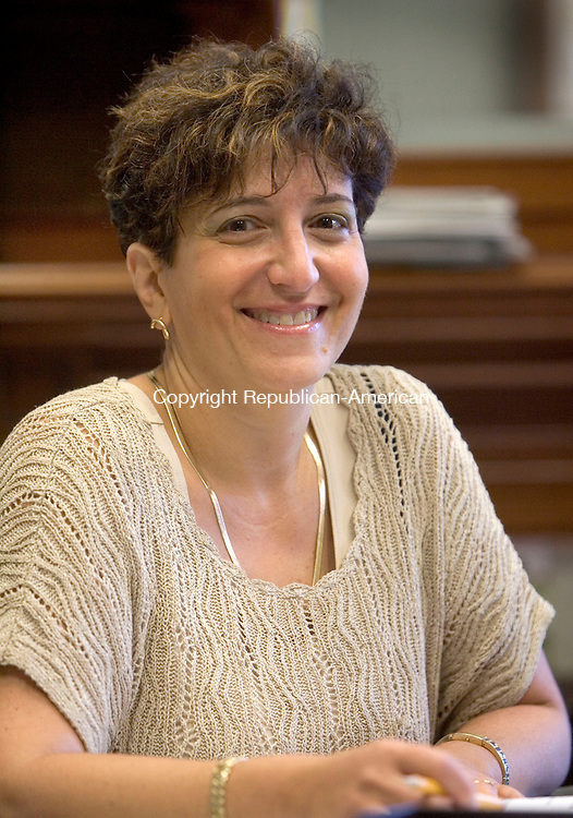 NAUGATUCK CT. 04 September 2013-090413SV07-Bernice Rizk works at her desk in the Board of Education building in Naugatuck Wednesday. Rizk, as assistant business manager for borough public schools, is also chairwoman of the St. Francis-St. Hedwig school board in Naugatuck.<br /> Steven Valenti Republican-American