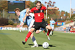 14 November 2010: UNC's Dustin McCarty (7) and Maryland's Casey Townsend (11). The University of Maryland Terrapins defeated the University of North Carolina Tar Heels 1-0 at WakeMed Soccer Park in Cary, North Carolina in the ACC Men's Soccer Tournament Championship game.