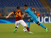 Barcellona's Neymar and  AS Roma's Alessandro Fiorenzi during the Champions League Group E soccer match   at the Olympic Stadium in Rome September 16, 2015