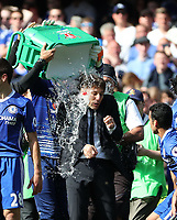 Antonio Conte Chelsea manager has water poured over him after winning 5-1 during the Premier League match between Chelsea v Sunderland, Stamford Bridge, London on 21st May 2017