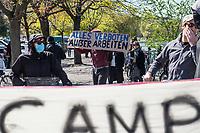 """Mit Transparenten, Plakaten und Flyern protestierten am Sonntag den 19. April 2020 in Berlin Menschen mit mehreren Flashmobs """"gegen das europaeische Grenzregime und die immer weiter zunehmenden Verbote der Meinungsaeusserung"""". Sie hielten dabei Schilder und Transparente, auf denen sie z.B. die Aufnahme der Fluechtlinge in den griechischen Fluechtlingslagern wie Moria forderten oder den Kapitalismus als Ursache fuer die Corona-Krise nannten.<br /> Im Bild: Menschen beim Flashmob auf der Admiralbruecke in Berlin Kreuzberg. Eine Person haelt ein Schild mit der Aufschrift """"Alles verboten ausser arbeiten"""".<br /> 19.4.2020, Berlin<br /> Copyright: Christian-Ditsch.de<br /> [NUR FUER REDAKTIONELLE ZWECKE! Werbung nur auf Anfrage beim Fotografen. Inhaltsveraendernde Manipulation des Fotos nur nach ausdruecklicher Genehmigung des Fotografen. Vereinbarungen ueber Abtretung von Persoenlichkeitsrechten/Model Release der abgebildeten Person/Personen liegen nicht vor. NO MODEL RELEASE! Don't publish without copyright Christian-Ditsch.de, Veroeffentlichung nur mit Fotografennennung, sowie gegen Honorar, MwSt. und Beleg. Konto: I N G - D i B a, IBAN DE58500105175400192269, BIC INGDDEFFXXX, Kontakt: post@christian-ditsch.de<br /> Bei der Bearbeitung der Dateiinformationen darf die Urheberkennzeichnung in den EXIF- und  IPTC-Daten nicht entfernt werden, diese sind in digitalen Medien nach §95c UrhG rechtlich geschuetzt. Der Urhebervermerk wird gemaess §13 UrhG verlangt.]"""