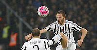 Calcio, Serie A: Juventus vs Inter. Torino, Juventus Stadium, 28 February 2016.<br /> Juventus&rsquo; Leonardo Bonucci, right, kicks the ball past his teammate Giorgio Chiellini during the Italian Serie A football match between Juventus and Inter at Turin's Juventus Stadium, 28 February 2016.<br /> UPDATE IMAGES PRESS/Isabella Bonotto