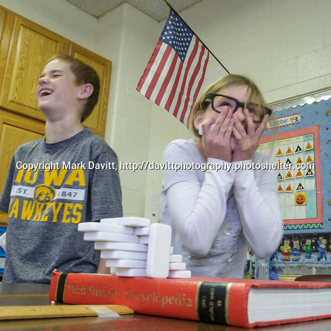 Four Mile Elementary School held a science fair Friday. Fourth graders Carter Underwood and Paige O'Riley work hard to engineer a hanging structure out of dominoes. For more please go to: http://tinyurl.com/know5yh.