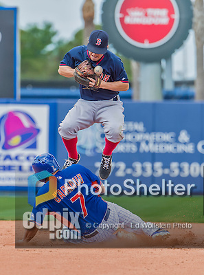 8 March 2015: Boston Red Sox infielder Brock Holt get New York Mets catcher Travis d'Arnaud out at second but is unable to turn the double play after bobbling the ball in the 4th inning of Spring Training action at Tradition Field in Port St. Lucie, Florida. The Mets fell to the Red Sox 6-3 in Grapefruit League play. Mandatory Credit: Ed Wolfstein Photo *** RAW (NEF) Image File Available ***
