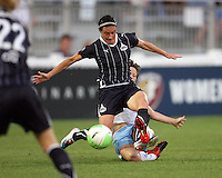 Sarah Huffman #14 of the Washington Freedom is tackled from behind by Megan Rapinoe #7 of the Chicago Red Star during a WPS match at the Maryland Soccerplex, in Boyds Maryland on June 12 2010. The game ended in a 2-2 tie.