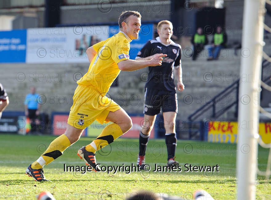 MARK ROBERTS CELEBRATES AFTER HE SCORES AYR'S FIRST FROM THE SPOT