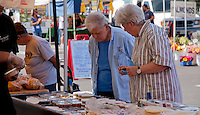 Three women shopping for hummus at SoCo Farmers' Market.  SR.