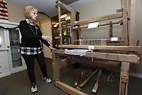 NWA Democrat-Gazette/FLIP PUTTHOFF <br /> MUSEUM ADDITION<br /> Liz Estes, director of the Lowell Historical Museum, shows Wednesday Jan. 9 2019 at  loom that is a new addition at the museum. The loom was used by the late Bessie Lucille Farell Kendrick of Springdale and was donated to the museum by her family. The loom is in working order, Estes said, and could be used for weaving today. The loom and all items at the museum can be seen Monday through Thursday from 9 a.m. to 2 p.m and 10 a.m. to 4 p.m. on Saturdays. It is closed on Fridays.