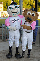 Asheville Tourists mascots Mr. Moon and Ted E Tourists mug for the camera during a game against the Rome Braves at McCormick Field on May 24, 2013 in Asheville, North Carolina. The Tourists won the game 6-0. (Tony Farlow/Four Seam Images).