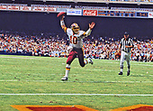 Washington Redskins quarterback Jay Schroeder (10) celebrates as he scores a touchdown on a one yard run in the second quarter against the Philadelphia Eagles at RFK Stadium in Washington, DC  on September 7, 1986.  The Redskins won the game 41 - 14.<br /> Credit: Arnie Sachs / CNP