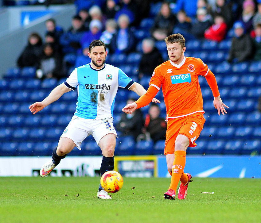 Blackburn Rovers' Craig Conway looks to get past Blackpool's Niall Maher<br /> <br /> Photographer Andrew Vaughan/CameraSport<br /> <br /> Football - The Football League Sky Bet Championship - Blackburn Rovers v Blackpool - Saturday 21st February 2015 - Ewood Park - Blackburn<br /> <br /> &copy; CameraSport - 43 Linden Ave. Countesthorpe. Leicester. England. LE8 5PG - Tel: +44 (0) 116 277 4147 - admin@camerasport.com - www.camerasport.com