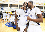 The Gazette Friendly High School's #0 Henry Hood, left, has a celebratory word with teammate #34 Bryan Brooks after Friendly beat Henry E. Lackey High School 77-60 in the 3A Maryland Public Secondary Schools Athletic Association Regional Finals on Saturday afternoon held at Dr. Henry a. Wise Jr. High School in Upper Marlboro.