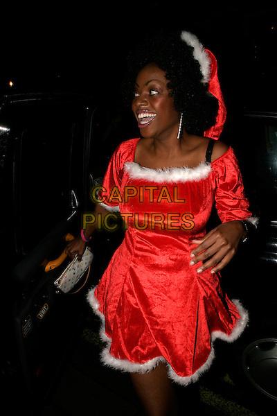 MAKOSI MUSAMBASI.OK! Magazine VIP Christmas Karaoke Party at Papageno, London, UK..December 14th, 2005.Ref: AH.half length red santa dress up costume.www.capitalpictures.com.sales@capitalpictures.com.© Capital Pictures.