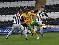 Filip Twardzik playing the ball under pressure from Barry Cuddihy (2) and Lewis McLear in the St Mirren v Celtic Scottish Professional Football League Under 20 match played at St Mirren Park, Paisley on 30.4.14.