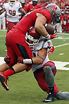Isaac Dotson, Washington State University safety, makes a perfect form tackle during the Cougars first road test of the season against Big Ten foe Rutgers at High Point Solutions Stadium in Piscataway, New Jersey, on September 12, 2015.  WSU came back from a late deficit to go on a 90 yard touchdown drive to score the winning TD with 13 seconds left to get the win, 37-34.