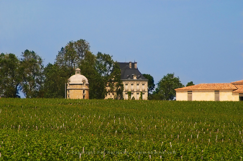 A view over the vineyard of Chateau Latour with the winery building to the right the 'Latour Tower' on the left and the chateau centre, Pauillac, Medoc, Bordeaux Pauillac Medoc Bordeaux Gironde Aquitaine France