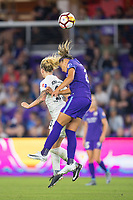 Orlando, FL - Saturday March 24, 2018: Utah Royals Gunnhildur Jonsdottir (23) and Orlando Pride defender Monica Hickman Alves (21) battle for a header during a regular season National Women's Soccer League (NWSL) match between the Orlando Pride and the Utah Royals FC at Orlando City Stadium. The game ended in a 1-1 draw.