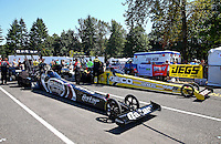 Aug. 4, 2013; Kent, WA, USA: NHRA top fuel dragster driver Shawn Langdon (left) and Morgan Lucas during the Northwest Nationals at Pacific Raceways. Mandatory Credit: Mark J. Rebilas-USA TODAY Sports