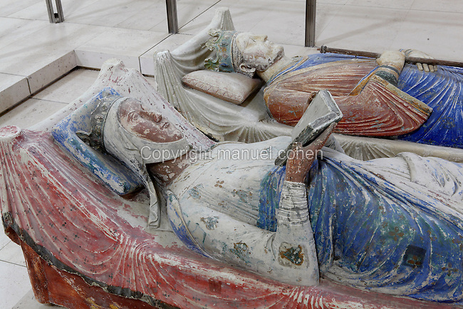 Royal effigies in abbey church of Fontevraud Abbey, Fontevraud-l'Abbaye, Loire Valley, Maine-et-Loire, France. These tombs are in the nave of the Romanesque abbey church and represent King Henry II Plantaganet of England, 1133-89, and his wife and queen Eleanor of Aquitaine, 1122-1204. They date from the 12th and 13th centuries and are topped with painted effigies of the dead, although their remains are no longer present, thought to have been destroyed during the French Revolution. The abbey itself was founded in 1100 by Robert of Arbrissel, who created the Order of Fontevraud. It was a double monastery for monks and nuns, run by an abbess. The order was dissolved during the French Revolution and the building subsequently used as a prison. Picture by Manuel Cohen