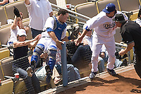 LOS ANGELES, CA - May 27: Catcher Russell Martin #55 of the Los Angeles Dodgers catches a foul ball then flips over the netting during a game with the Chicago Cubs on May 27, 2007 at Dodger Stadium in Los Angeles, California. The Dodgers defeated the Cubs 2-1 in 11 innings.