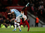 Riyad Marhez of Manchester City upends Brandon Williams of Manchester United during the Carabao Cup match at Old Trafford, Manchester. Picture date: 7th January 2020. Picture credit should read: Darren Staples/Sportimage